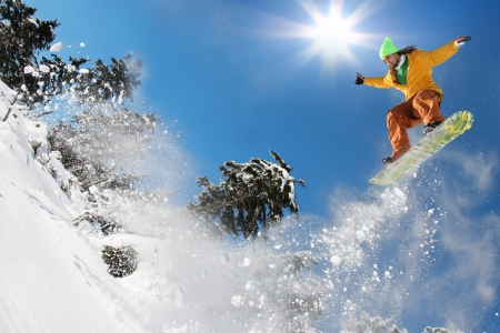 snowboard: Snowboarder jumping against blue sky  Stock Photo