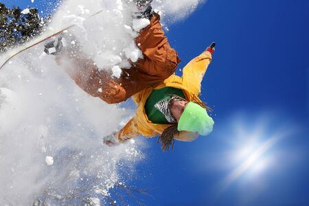 snow drop: Snowboarder jumping against blue sky Stock Photo