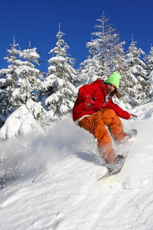 Snowboarder in action photo