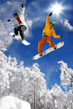 air jump: Snowboarders jumping against blue sky Stock Photo
