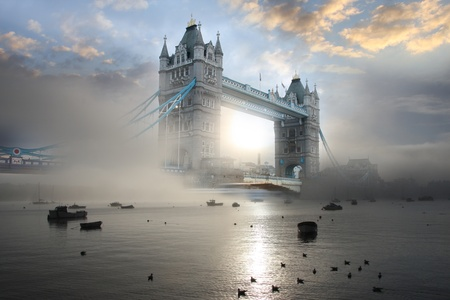 Tower Bridge in foggy morning in London, UK photo
