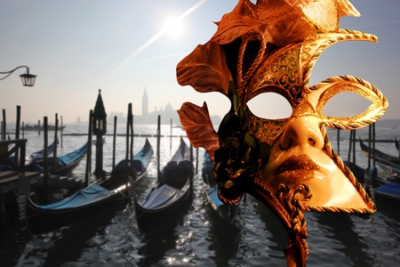 Venice with gondolas and carnival mask in Italy photo