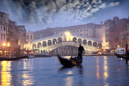 Venice with Gondolier on Grand Canal, Italy  photo