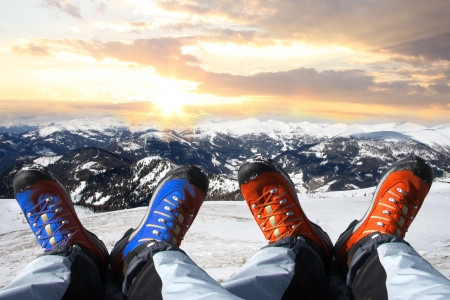 Winter shoes against sunset over the Alps  Stock Photo