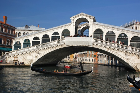 Venice, Rialto bridge with gondola in Italy  Stock Photo - 12074808