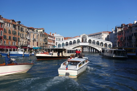 rialto bridge: Venice, Rialto bridge with boats in Italy  Stock Photo