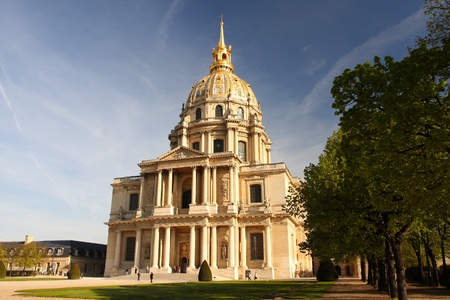 blossoming yellow flower tree: Paris, Les Invalides in spring time, famous landmark, France  Stock Photo