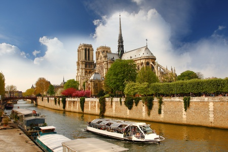 dame: Paris, Notre Dame with boat on Seine, France  Stock Photo