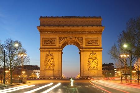 Paris, Famous Arc de Triumph in evening , France  photo