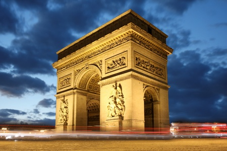Arc de Triomphe: Paris, Famous Arc de Triumph in evening , France  Stock Photo