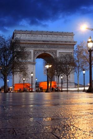 triumphal: Paris, Famous Arc de Triumph in evening , France  Stock Photo