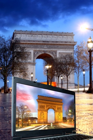 Paris, Famous Arc de Triumph in evening , France  photo