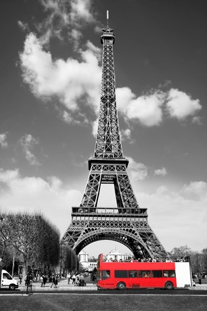 Eiffel Tower with red bus in Paris, France