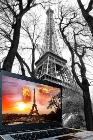 Eiffel Tower with laptop in Paris, France photo