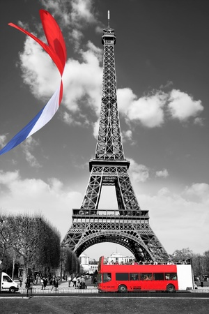 parisian: Stock Photo: Famous Eiffel Tower with colorful flag in Paris, France