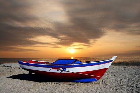 fishing boat against beautiful sunset  photo