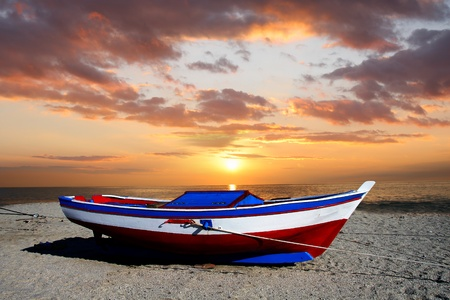 calabria: fishing boat against beautiful sunset