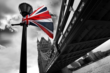 morning night: London Tower Bridge with colorful flag of England  Stock Photo