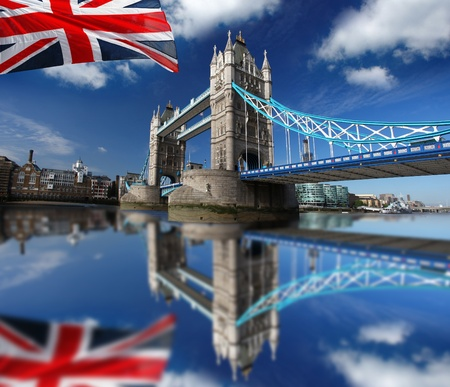 London Tower Bridge with colorful flag of England photo