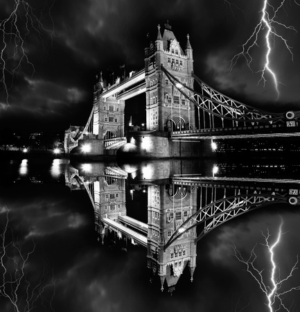 Tower Bridge with lightnings at stormy night in London, UK  photo