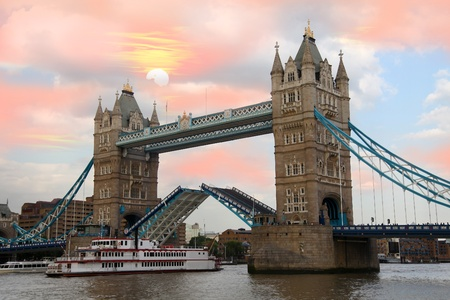 london tower bridge: Famous Tower Bridge with city cruise in London, UK