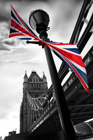 london city: London Tower Bridge with colorful flag of England  Stock Photo