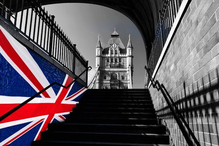 London Tower Bridge with colorful flag of England  Stock Photo