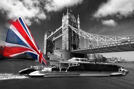 day night: London Tower Bridge with colorful flag of England  Stock Photo