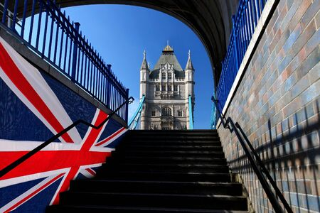 Tower Bridge with flag of England in London, UK photo