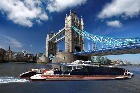 Famous Tower Bridge with city cruise in London, UK photo