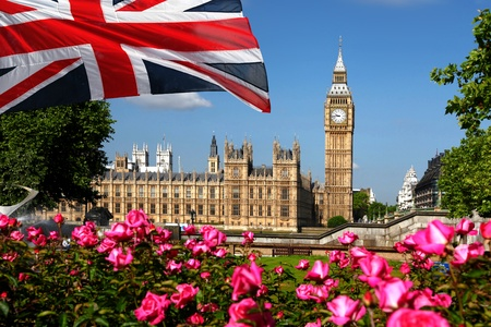london city: Big Ben with flag of England, London, UK  Stock Photo