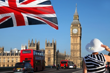 london tower bridge: Big Ben with flag of England, London, UK  Stock Photo