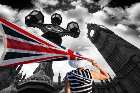 english famous: Big Ben with flag of England, London, UK  Stock Photo