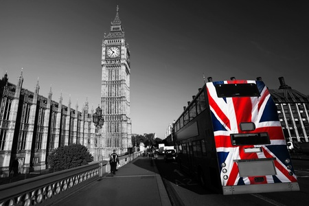 Big Ben with city bus covered flag of England, London, UK  photo
