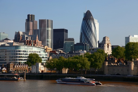 thames: Modern London cityscape with boat, LONDON, UK