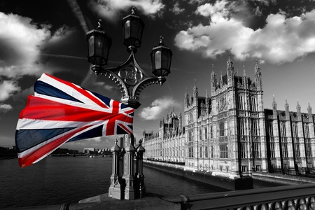 united kingdom: Parliament  with flag of England, London, UK