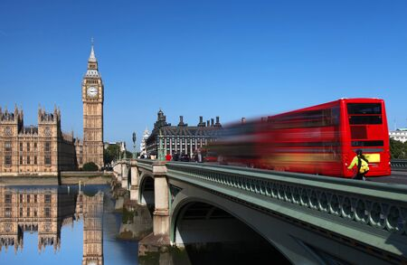 big game: Big Ben with bridge and city bus in  London, UK Stock Photo