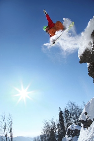 Snowboarder jumping against blue sky Stock Photo - 12535252