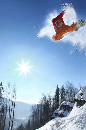 Snowboarder jumping against blue sky Stock Photo - 12535273