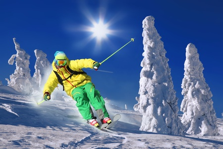 Skier in high mountains photo
