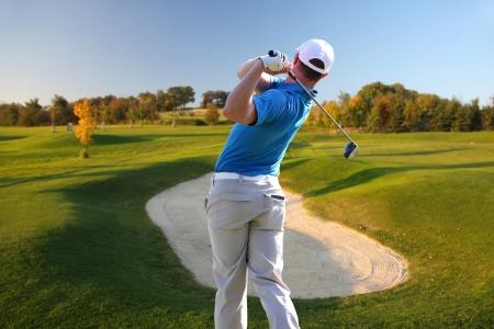 golf swing: Man playing golf