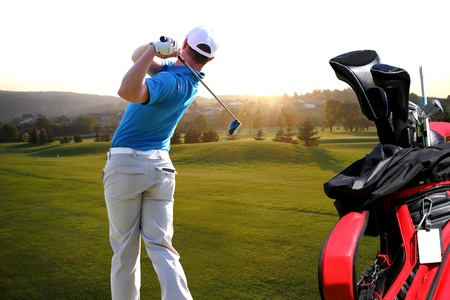 Man playing golf with golf bag photo