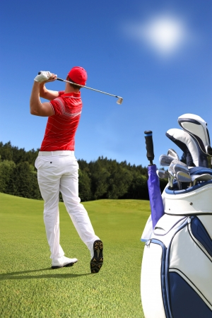 Man playing golf with golf bag Stock Photo - 12539074