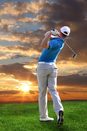 play golf: Man playing golf against sunset