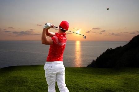 playing golf: Man playing golf against sunset over sea