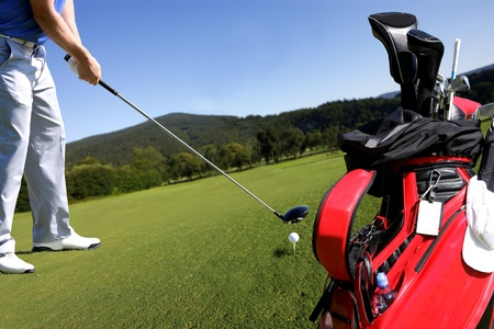 country club: Man playing golf with golf bag