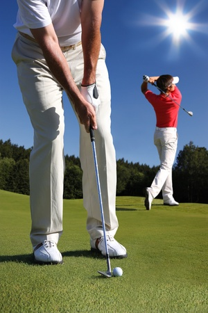 golf swings: Men playing golf