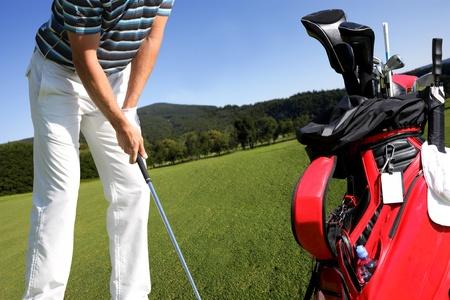 golf swing: Man playing golf with golf bag