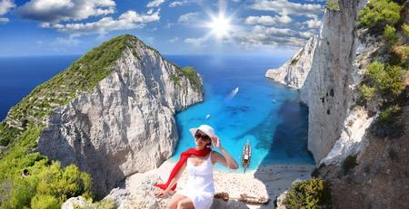 Navagio beach with woman on cliff, Zakynthos Island, Greece  photo