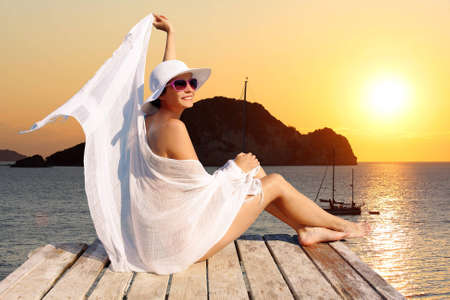 sunsets: Sexy  Woman against sunset over sea  Stock Photo